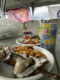 宮城県雄勝の牡蠣、ホヤ、秋刀魚、三陸の海の味覚揃い踏み、氷結と一緒に!復興を願って。の写真・画像素材[1341478]