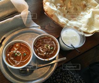 テーブルの上に食べ物のボウルの写真・画像素材[759522]