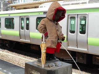 レインコート,レインコートの小便小僧,梅雨どきの衣装,梅雨どきの小便小僧,傘を持ってる小便小僧