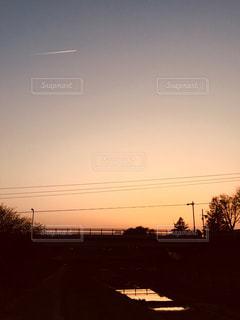 夕焼け,飛行機雲