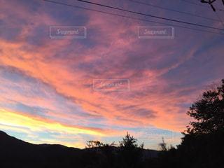 田舎の夕陽の写真・画像素材[1273613]