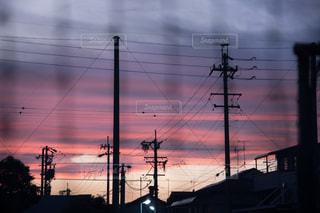 夕日,影,電線,学校,ネット,住宅街,グラデーション,運動場