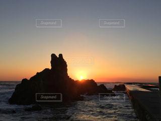 空,夕日,夕焼け,犬岩