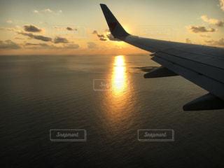 海,空,夕日,飛行機,飛行機の翼