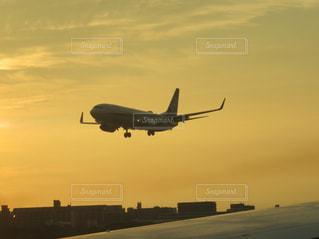 夕焼け空,福岡空港,空の旅,夕焼け小焼け,飛行機好き,飛行機のシルエット,離陸待ち,着陸する飛行機