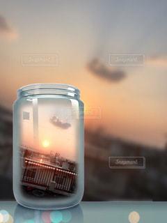 空,夕日,夕焼け,オレンジ,瓶,屋上