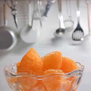 食べ物,キッチン,室内,フルーツ,果物,果実,キッチンツール,オレンジ色,食材,ぽんかん,蜂蜜かけ