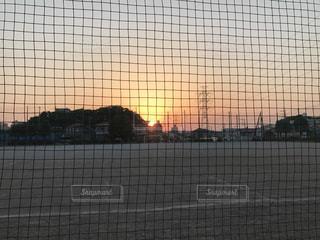 空,公園,夕日,夕焼け,夕暮れ,しんみり,野球少年