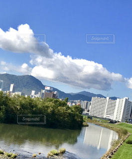 豊平川と街並みの写真・画像素材[1499351]