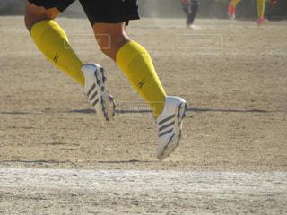 スポーツ,足,男,土,サッカー,高校生,運動,脚,グラウンド,スパイク