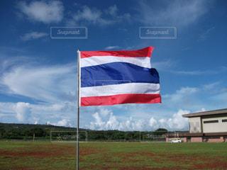 南国の青空と国旗の写真・画像素材[1328709]