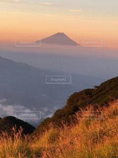赤岳から。朝日の中の富士山。の写真・画像素材[1407539]