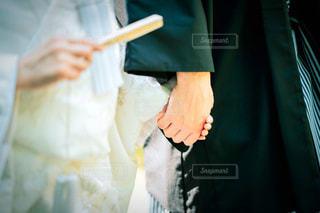 手を繋いだ夫婦の写真・画像素材[1878933]