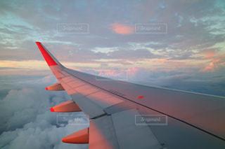 空,ピンク,白,青,夕焼け,飛行機,未来,雲海,夕陽,翼,夢,ポジティブ,目標,前向き,可能性