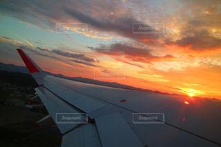 空,ピンク,夕焼け,飛行機,未来,雲海,夕陽,翼,夢,ポジティブ,目標,前向き,可能性