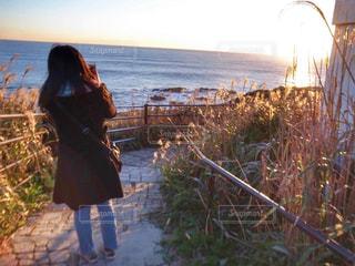 太陽と向き合う女○の写真・画像素材[1262109]