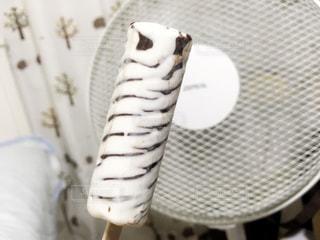 アイスと扇風機の組み合わせ◎の写真・画像素材[1399714]