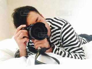 カメラ,ボーダー,布団,カメラマン,寝そべり,Nikon,ベッド,撮り合いっこ