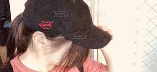 帽子をかぶっている人の写真・画像素材[1444731]