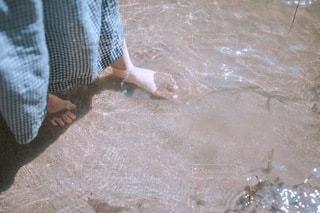 砂の中の人の写真・画像素材[3635523]