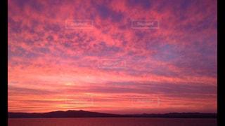 海,ピンク,夕焼け