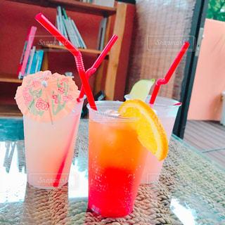オレンジ ジュースのガラスの写真・画像素材[1436232]