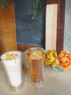 オレンジ ジュースのガラスの写真・画像素材[1441612]