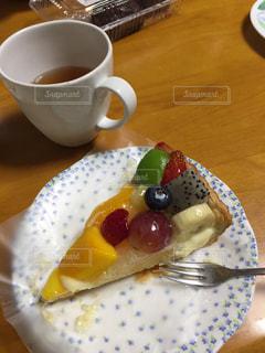 フォークとコーヒーのカップ食品のプレートの写真・画像素材[1521137]