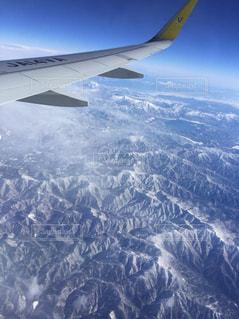 大型航空機を空中に高く飛ぶの写真・画像素材[1732260]