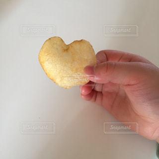 手,ハート,お菓子,ポテトチップス,ポテチ,じゃがいも
