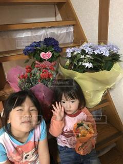 花に囲まれての写真・画像素材[3084558]