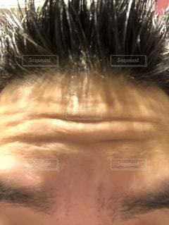 39年の月日を経た髪と額の写真・画像素材[1693558]