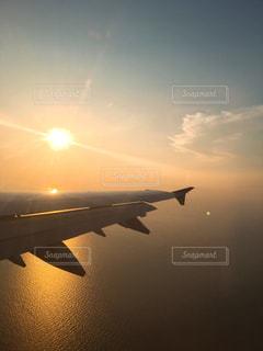夕日,夕焼け,飛行機,オレンジ,旅行,未来,韓国,ポジティブ,インスタ映え