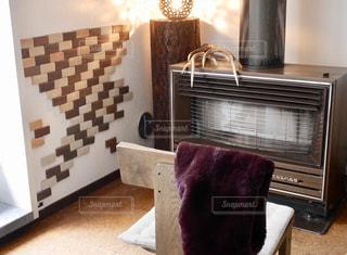 暖炉とマフラーの写真・画像素材[1697316]