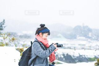 人が雪の中に立っています。の写真・画像素材[1646841]