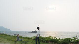 海,夕日,太陽,人物,人,未来,夢,ポジティブ,希望,目標,可能性