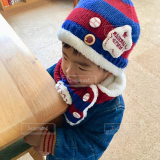 帽子をかぶった小さな男の子の写真・画像素材[1688824]