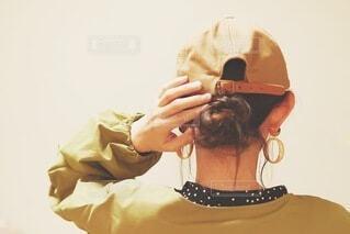 帽子をかぶった人の写真・画像素材[3700644]
