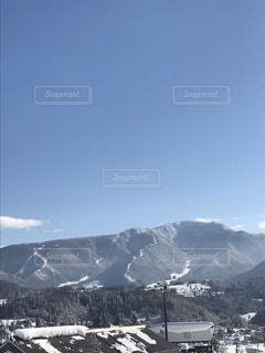 雪の覆われた山々の写真・画像素材[1736644]