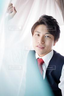 スーツとネクタイを身に着けている男の写真・画像素材[1693032]