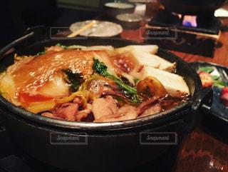 近くに食物を中パンのアップの写真・画像素材[1708138]