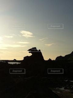 夕陽,秋田,男鹿,ゴジラ岩