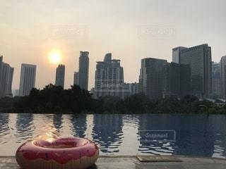 空,海外,朝日,プール,夕焼け,マレーシア,浮き輪