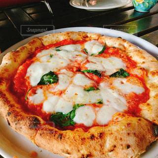 どっかのカフェで食べたピザの写真・画像素材[2093406]