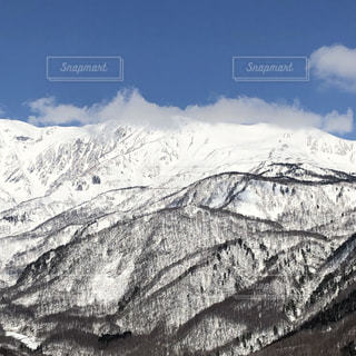 雪に覆われた北アルプスの写真・画像素材[3084995]
