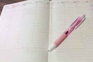 スケジュール帳とペンの写真・画像素材[1998419]
