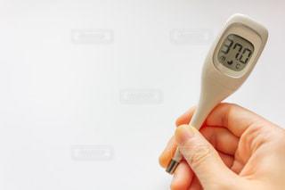 体温計と微熱の写真・画像素材[2065810]