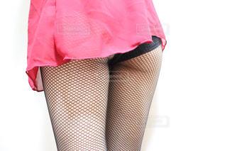 ピンクのシャツを着ている人の写真・画像素材[2801779]