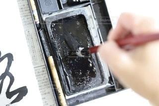 墨をつける筆の写真・画像素材[3536290]