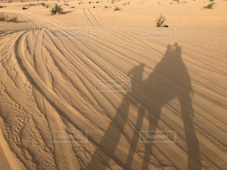 砂漠、ラクダと共に。の写真・画像素材[1841206]